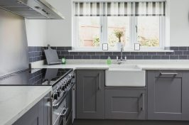 Classic styled kitchen with grey cupboard doors